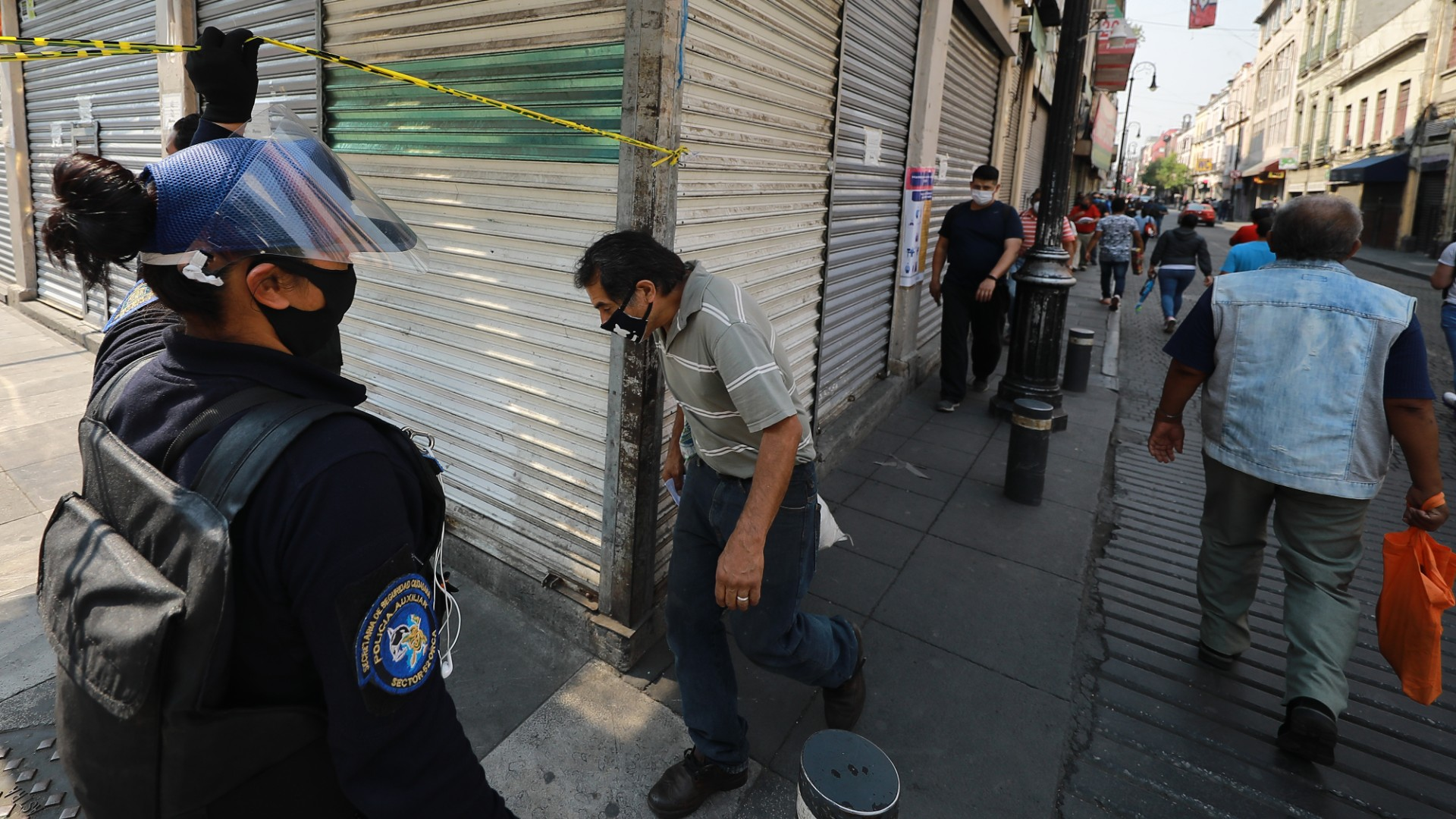 Police control the passage of people to Corregidora street where there are shops for construction products during health emergency to curb spread of COVID-19 on May 20, 2020 in Mexico City, Mexico. (Hector Vivas/Getty Images)