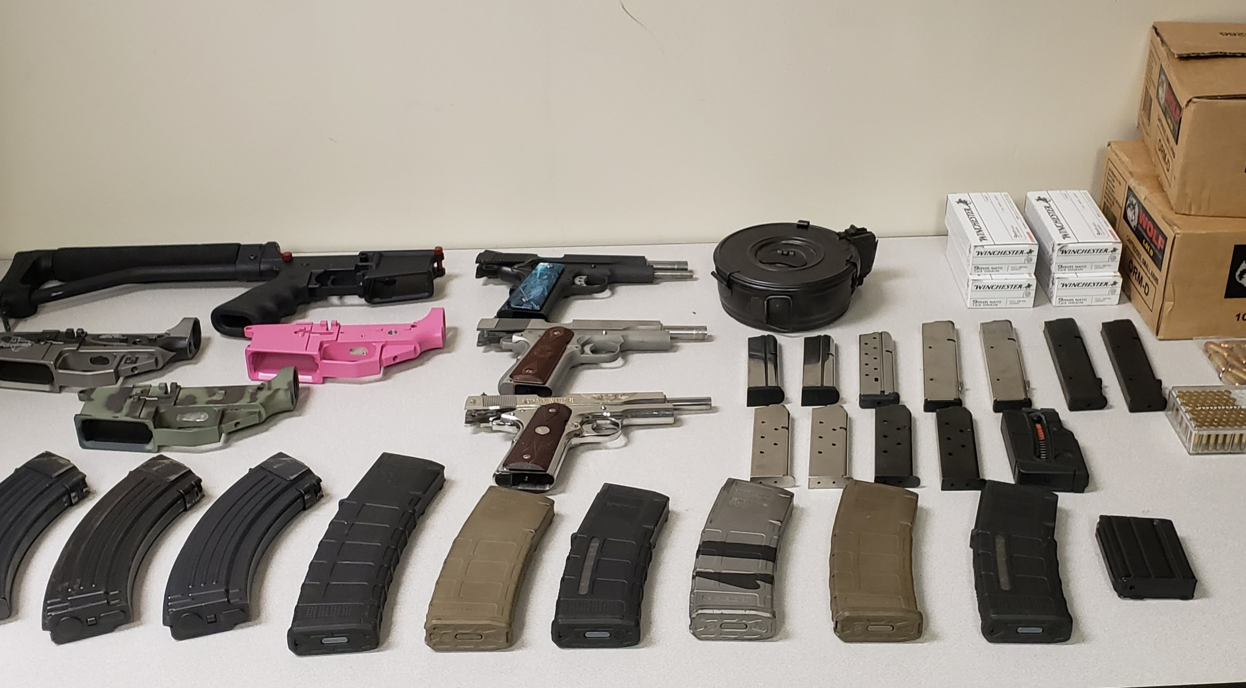 The California Attorney General's Office released this photo of firearms and ammunition seized from Rene Navas of Lancaster on May 11, 2020.