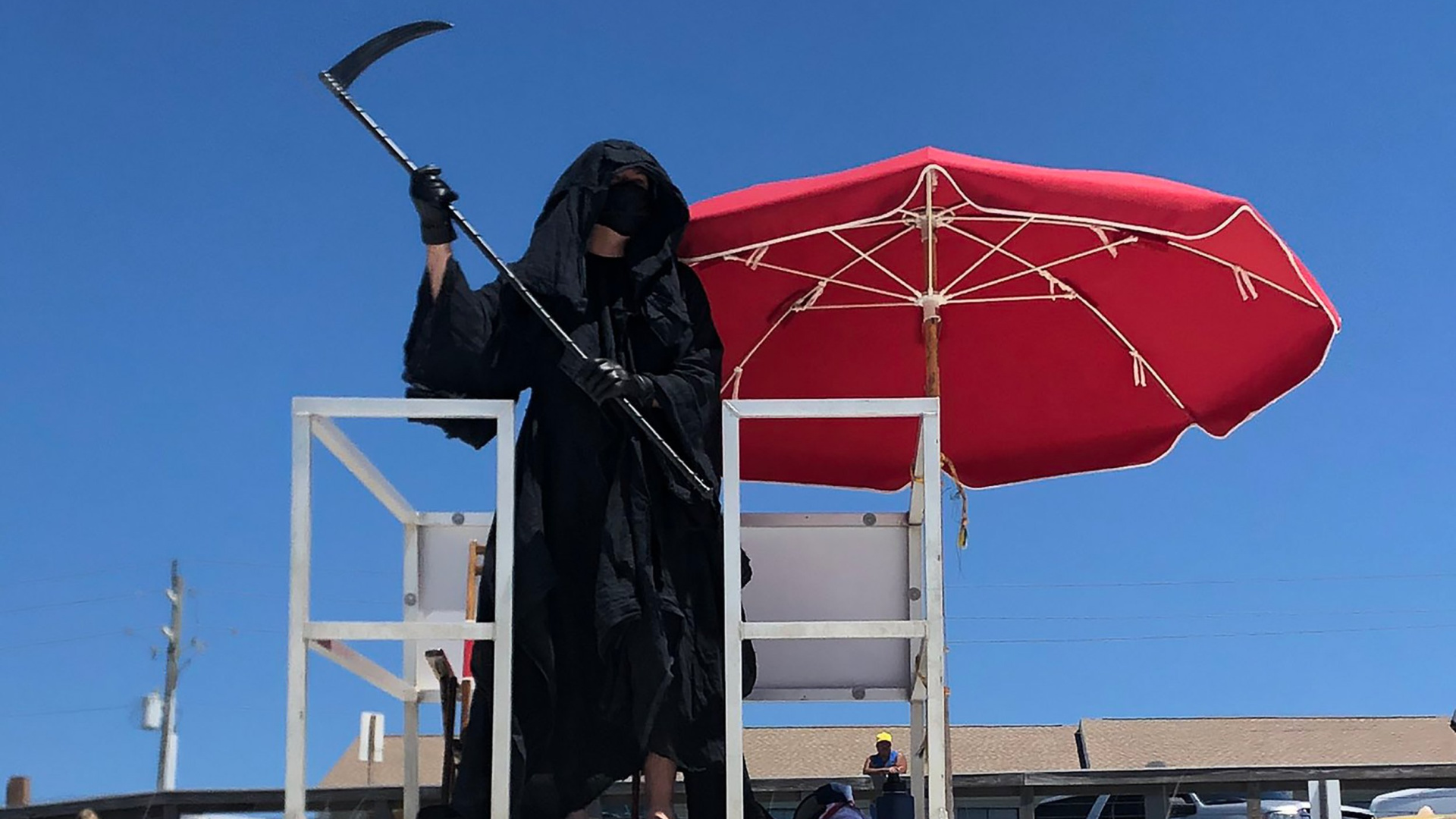 Daniel Uhlfelder is seem dressed as the Grim Reaper at a Florida beach. (Daniel Uhlfelder via CNN)