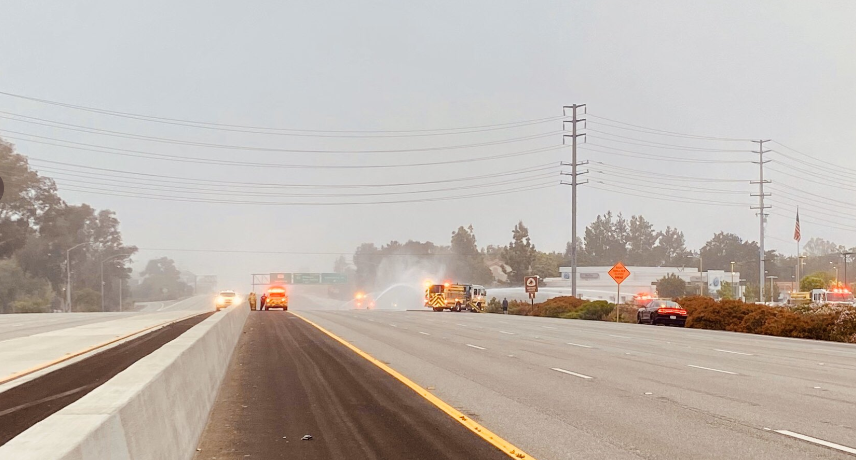 Firefighters put out flames engulfing a semi-truck along the 101 Freeway in Thousand Oaks on May 10, 2020 (California Highway Patrol - Moorpark via Twitter)