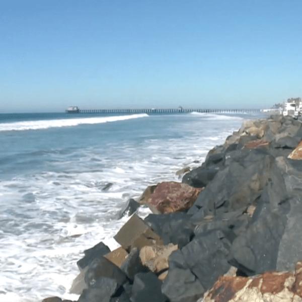 Waves hit the rocks at Seal Beach in May 2020. (KTLA)