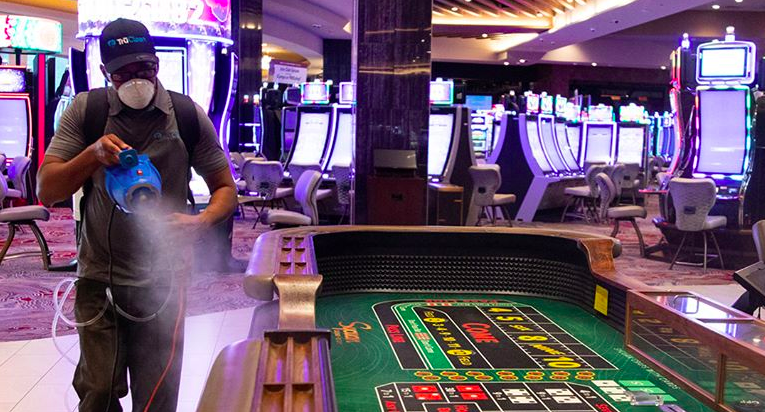 A man sanitizes a table at the Sycuan Casino Resort in El Cajon in a photo posted to the casino's Facebook page on May 7, 2020.