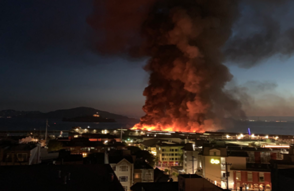 Flames and smoke are seen from Pier 45 in San Francisco on May 23, 2020. (Jack Hutton/Twitter)