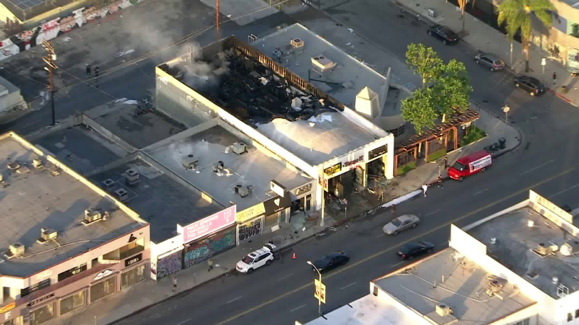 Smoke rises from the roof of a building on Melrose Avenue on May 30, 2020. (Sky5)