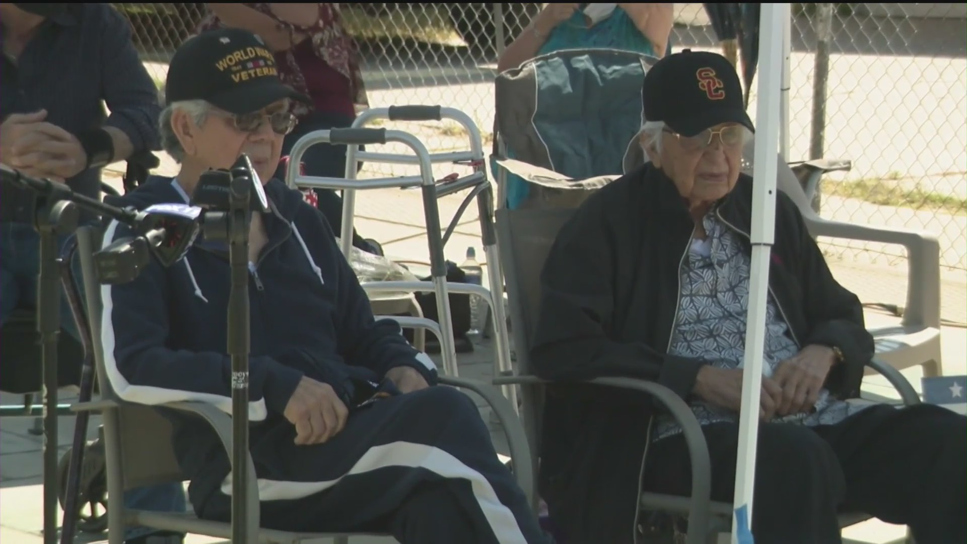 "World War II veterans Salvador ""Sal"" Guzman, left, and Randel ""Randy"" Fernandez, right, celebrate their 97th and 96th birthdays, respectively, in Whittier on May 24, 2020. (KTLA)"