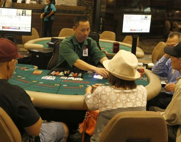 Card players try their luck at the Gardens Casino in Hawaiian Gardens in 2016. (Glenn Koenig / Los Angeles Times)