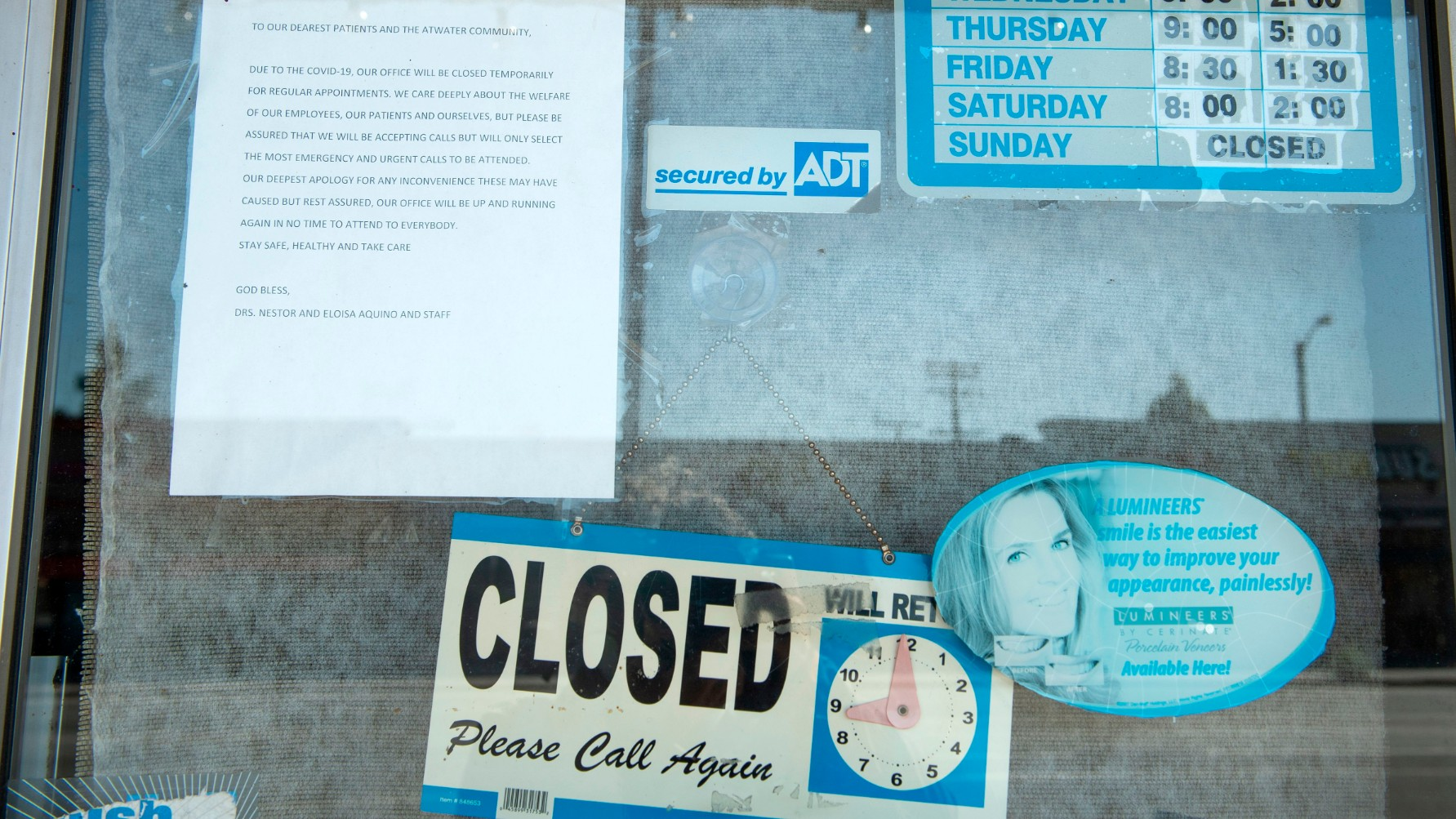 A sign displayed on the door tells clients that the shop is closed due to corovirus amid the Covid 19 pandemic, May 4, 2020, in Glendale. (VALERIE MACON/AFP via Getty Images)