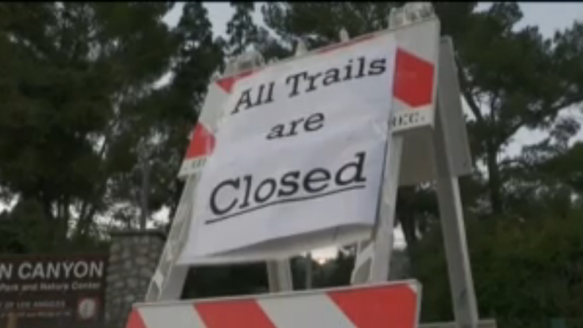 A trail closure is sign is posted in Eaton Canyon on May 24,