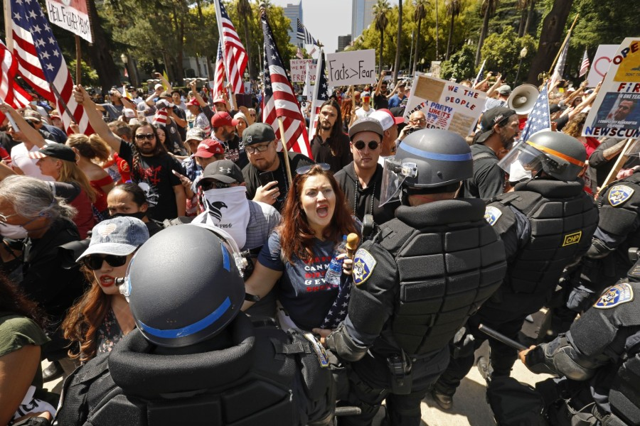 Alicia Cruz, center, of El Grove, takes part in a protest at the California State Capitol on May 1, 2020. (Credit: Carolyn Cole / Los Angeles Times)