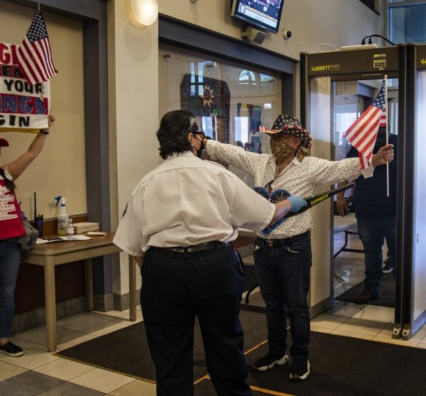 Protesters enter the County Administrative Center for a Riverside County Board of Supervisors meeting in May 2020. (Gina Ferazzi/Los Angeles Times)