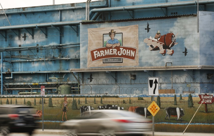 At least 153 workers at the Farmer John plant in Vernon have been diagnosed with COVID-19.(Al Seib / Los Angeles Times)