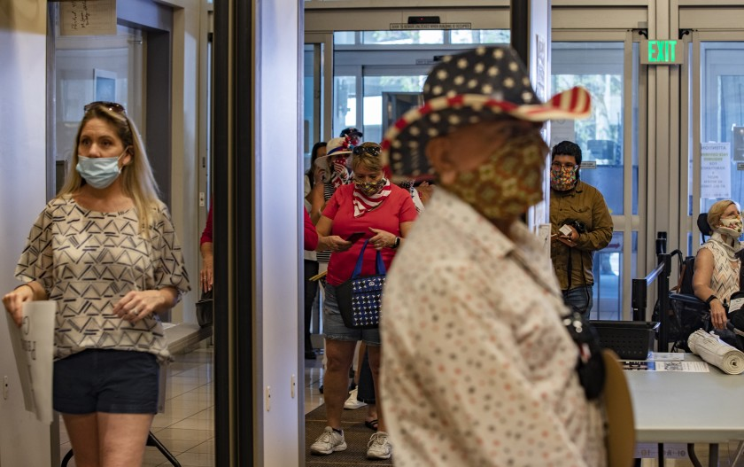 Spectators enter the Riverside County Administrative Center during the Board of Supervisors meeting on May 5, 2020. (Gina Ferazzi / Los Angeles Times)