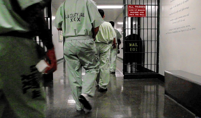 Inmates walk to their cell blocks at the L.A. County Jail. (Gina Ferazzi / Los Angeles Times)