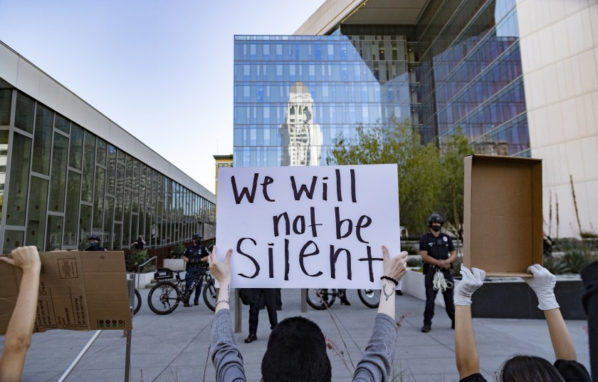 Black Lives Matter protesters rally in front of LAPD officers in riot gear on May 28, 2020. (Gina Ferazzi/Los Angeles Times)