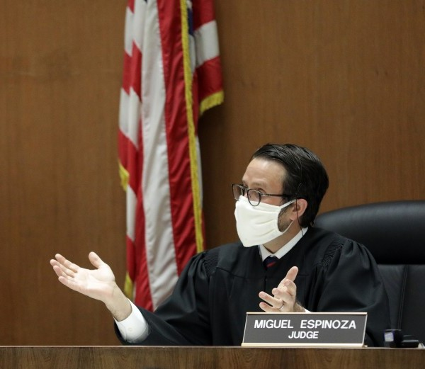 Los Angeles Superior Court Judge Miguel Espinoza holds arraignments in his courtroom via video at Clara Shortridge Foltz Criminal Justice Center on April 21 in Los Angeles.(Myung J. Chun/Los Angeles Times)