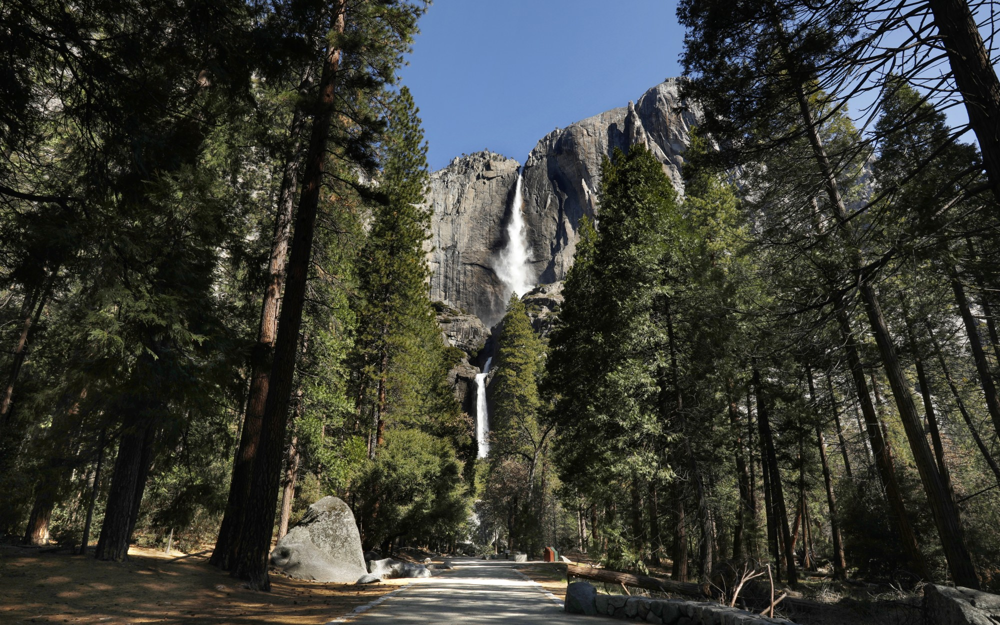 An empty trail leads to the Upper and Lower Yosemite Falls while the national park is closed due to coronavirus in April 2020. (Carolyn Cole / Los Angeles Times)