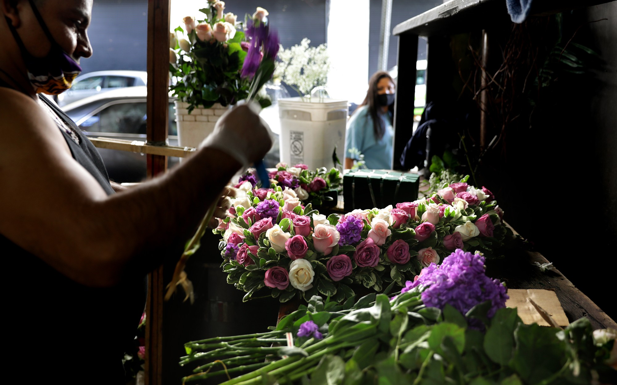 Jaime Miranda creates an arrangement at Lupita's Flowers in downtown Los Angeles ahead of Mother's Day weekend.(Christina House / Los Angeles Times)