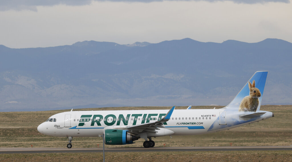 A Frontier Airlines jetl taxis for takeoff from Denver International Airport in Denver. (AP Photo/David Zalubowski)