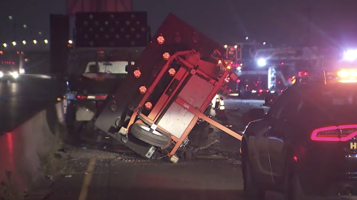 Two Caltrans workers were injured when a car crashed into a sign trailer in Huntington Beach on April 30, 2020. (KTLA)