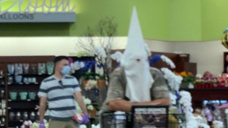 A man seen wearing a KKK hood in a California grocery store will not face any charges. (Alisa Wentzel via CNN Wire)