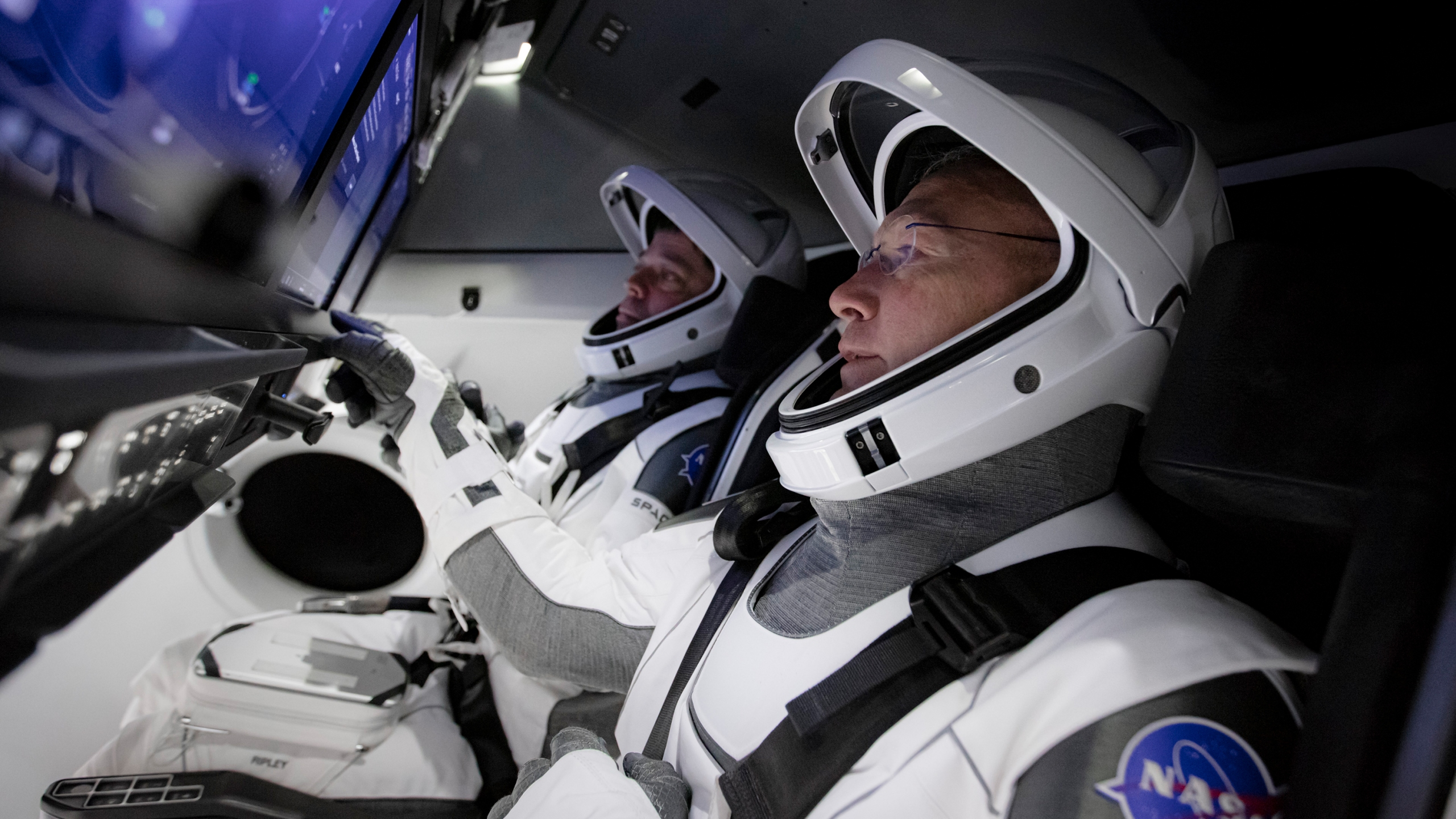NASA astronauts Bob Behnken, left, and Doug Hurley have spent years learning how to operate SpaceX's Crew Dragon capsule. (SpaceX via CNN Wire)