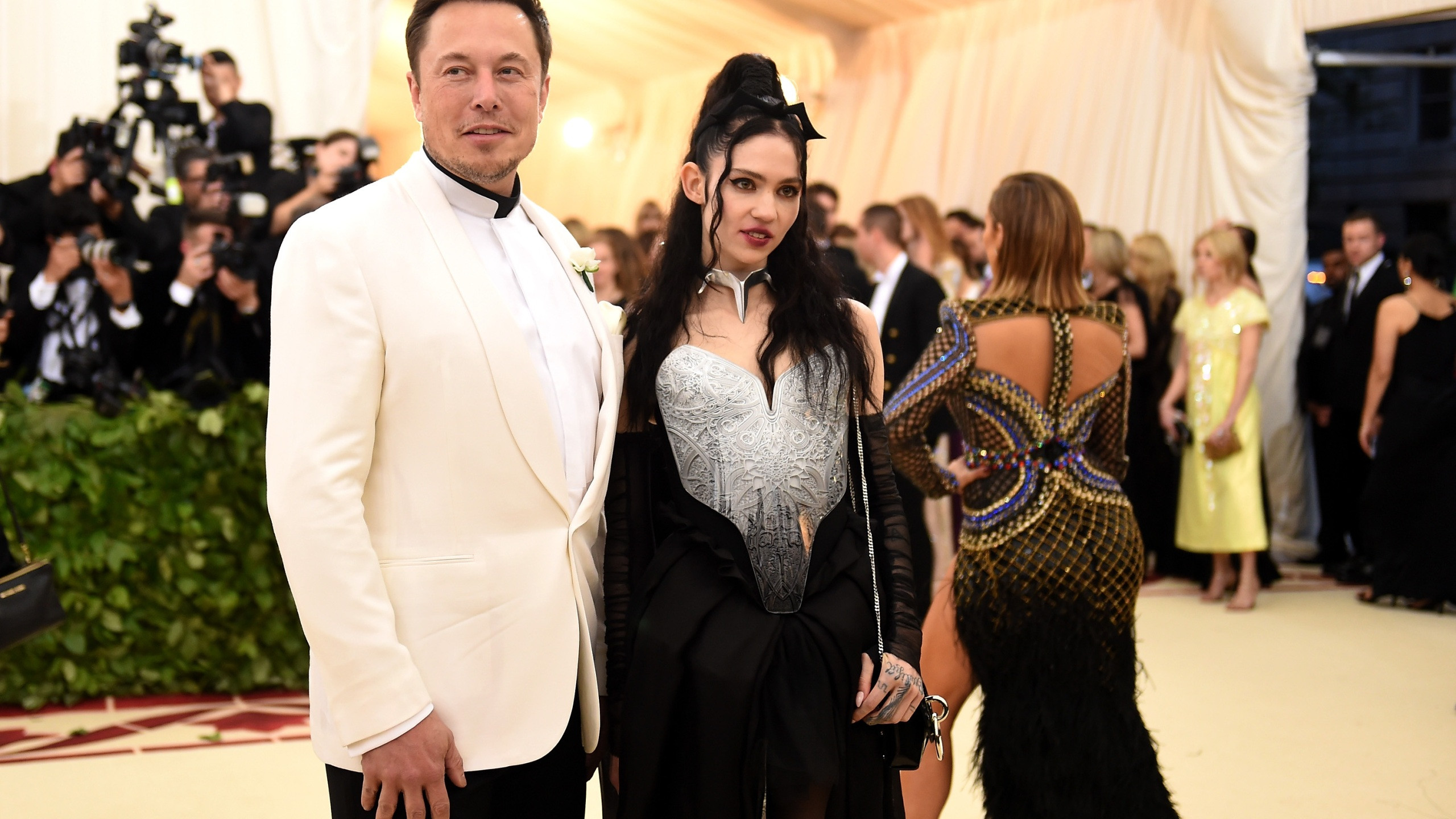 Elon Musk and Grimes attend the Heavenly Bodies: Fashion & The Catholic Imagination Costume Institute Gala at The Metropolitan Museum of Art on May 7, 2018 in New York City. (Jason Kempin/Getty Images)