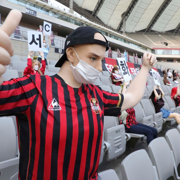 In this May 17, 2020 photo, cheering mannequins are installed at the empty spectators' seats before the start of a soccer match between FC Seoul and Gwangju FC at the Seoul World Cup Stadium in Seoul, South Korea. (Ryu Young-suk/Yonhap via AP)