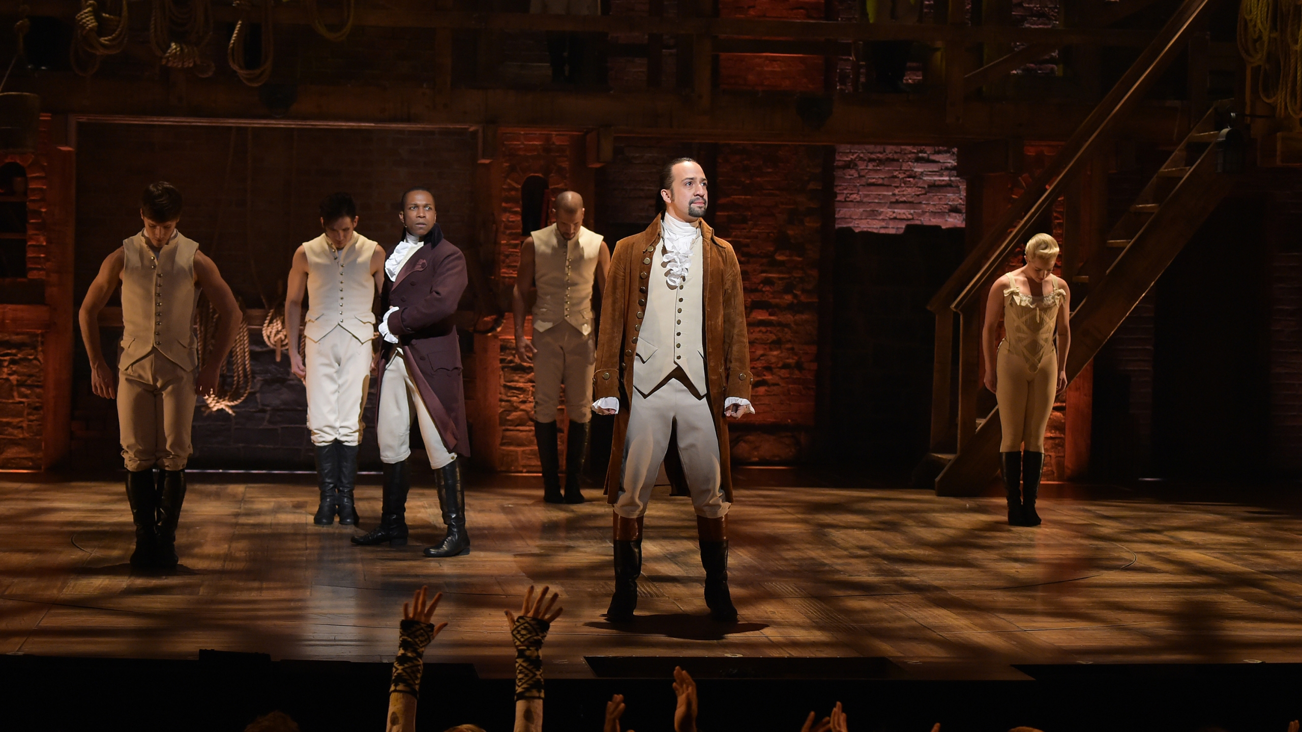 "Actor Leslie Odom, Jr. (L) and actor, composer Lin-Manuel Miranda (R) perform on stage during ""Hamilton"" GRAMMY performance for The 58th GRAMMY Awards at Richard Rodgers Theater on February 15, 2016 in New York City. (Theo Wargo/Getty Images)"