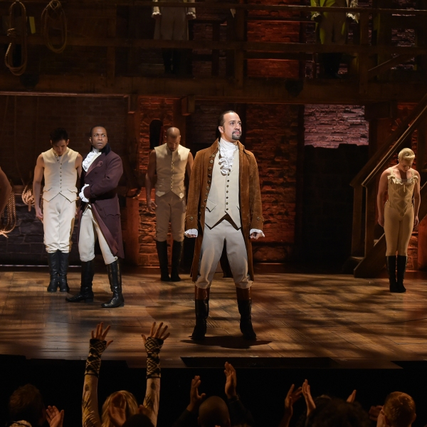 """Actor Leslie Odom, Jr. (L) and actor, composer Lin-Manuel Miranda (R) perform on stage during """"Hamilton"""" GRAMMY performance for The 58th GRAMMY Awards at Richard Rodgers Theater on February 15, 2016 in New York City. (Theo Wargo/Getty Images)"""