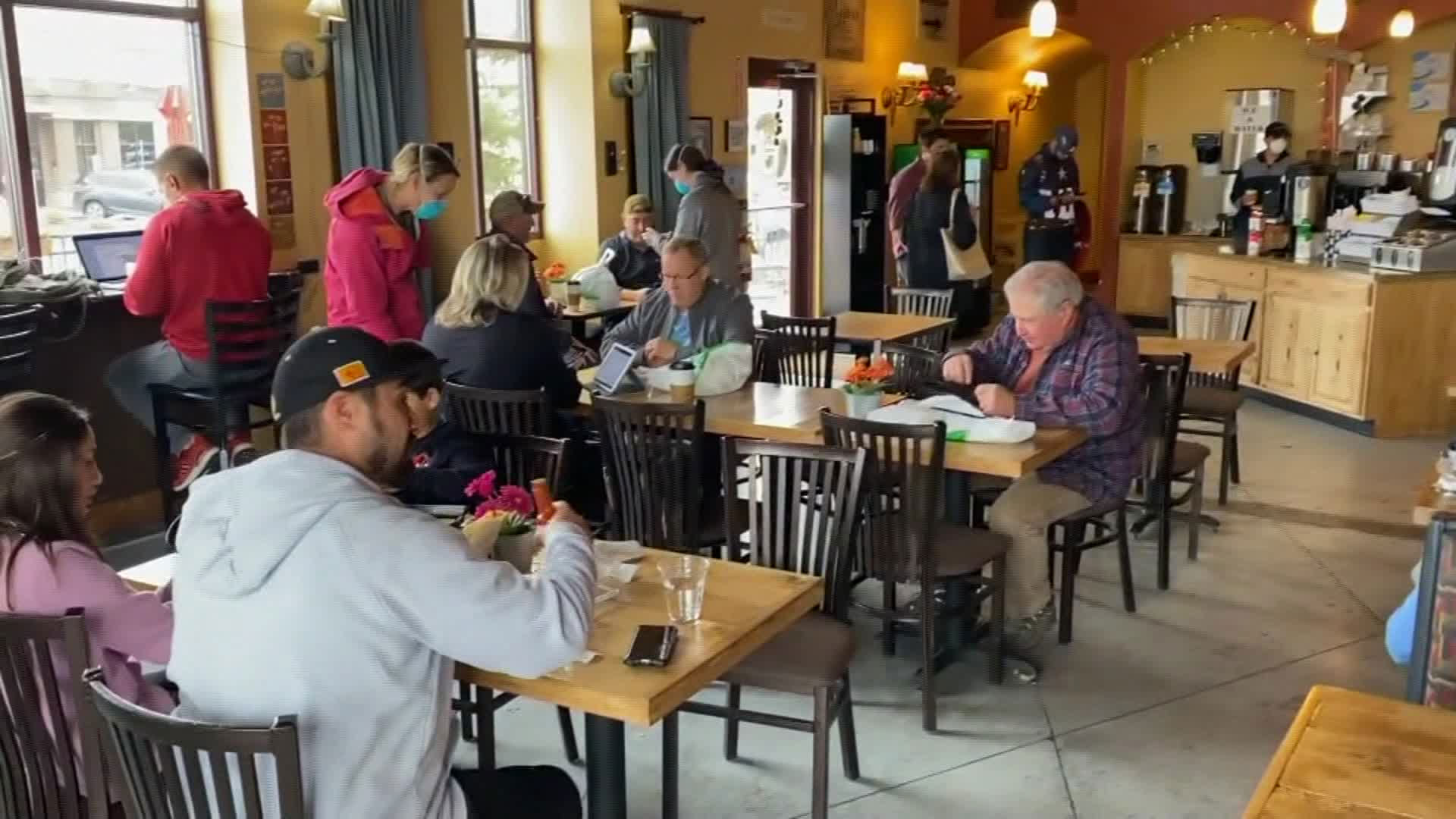 An image taken from video shows many people, mostly without masks, crowded into a Colorado restaurant on Mothers Day. (KCNC via CNN Wire)