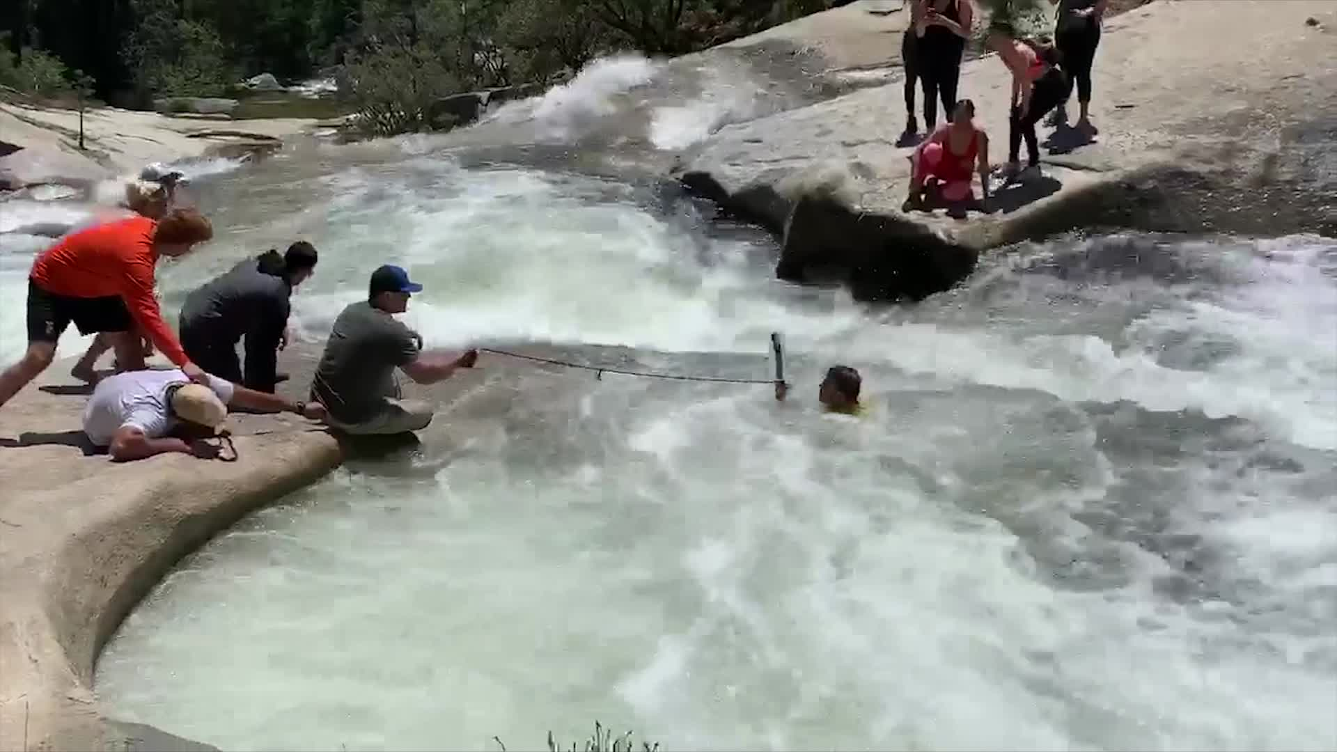 An off-duty officer saves a 24-year-old hiker who was trapped in a whirlpool near Bass Lake in Madera County on May 9, 2020. (CHP via CNN)
