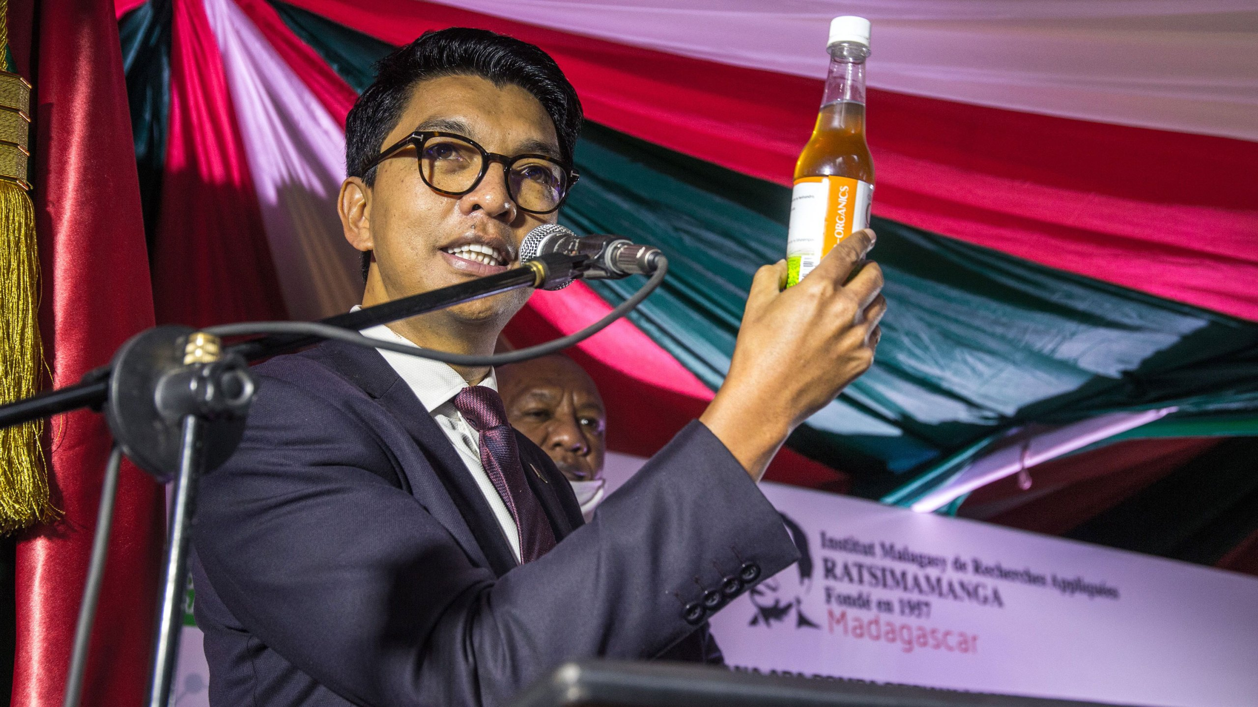 "The President of Madagascar Andry Rajoelina attends a ceremony to launch ""Covid Organics"" or CVO, in Antananarivo, on 20 April 2020, a remedy from the Malagasy Institute of Applied Research (IMRA) created from the Artemisia plant and supposed to prevent any infection by the new coronavirus COVID-19. ( RIJASOLO/AFP via Getty Images)"