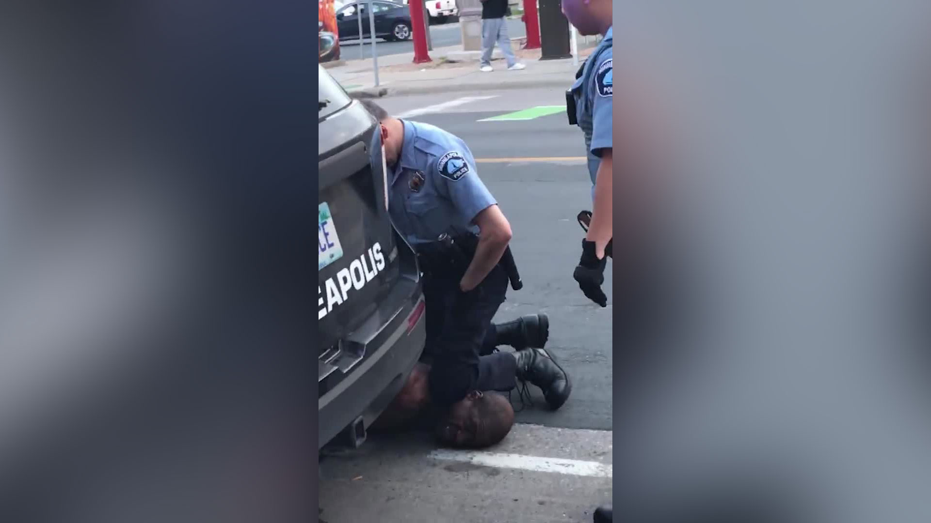 A video that circulated on social media showed two officers by the man on the ground -- one of them had his knee over the back of the man's neck. (Facebook/Darnella Frazier)