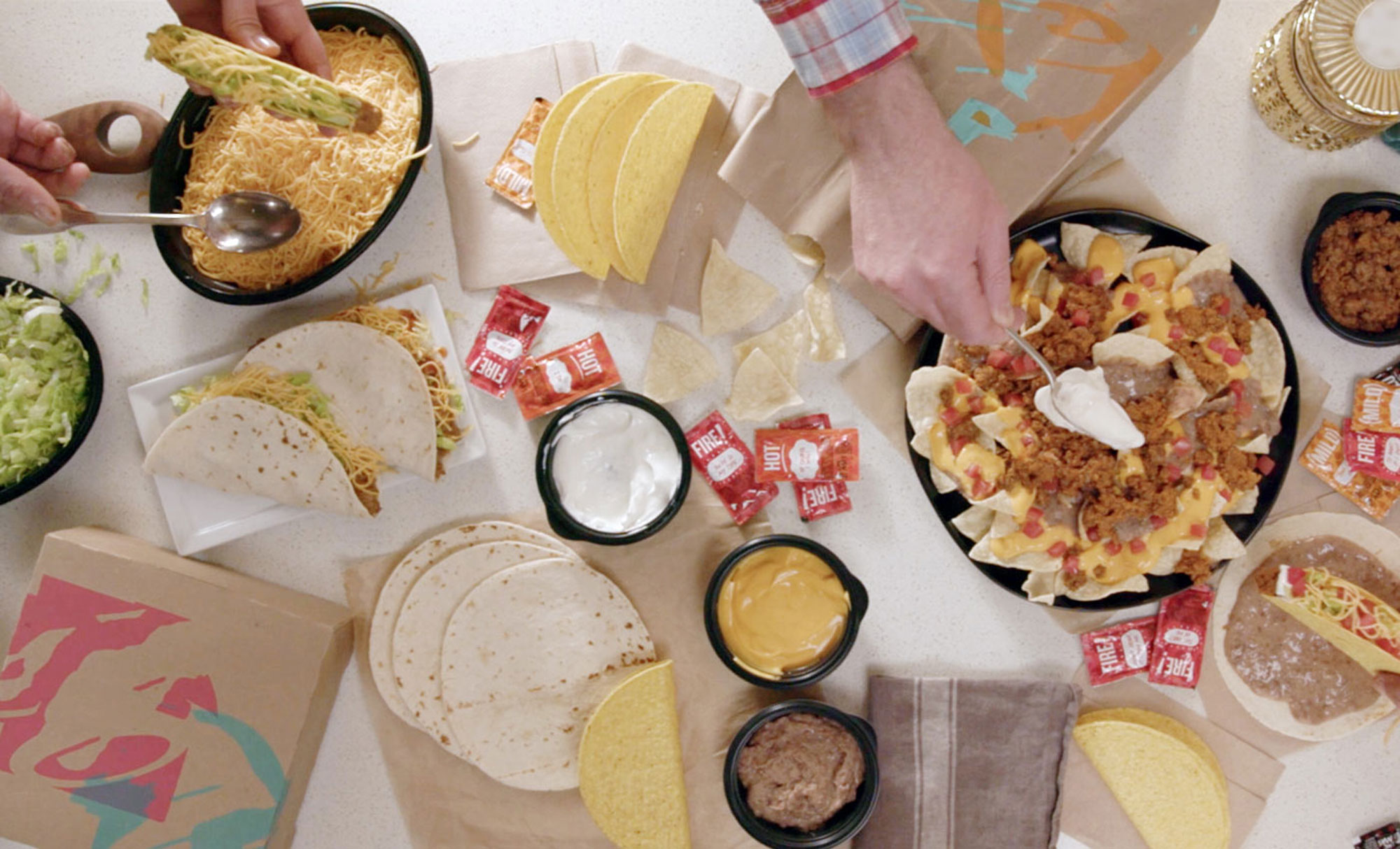 "Taco Bell's ""At Home Taco Bar"" can feed six people for $25 and is available by delivery or drive-thru. (Taco Bell)"