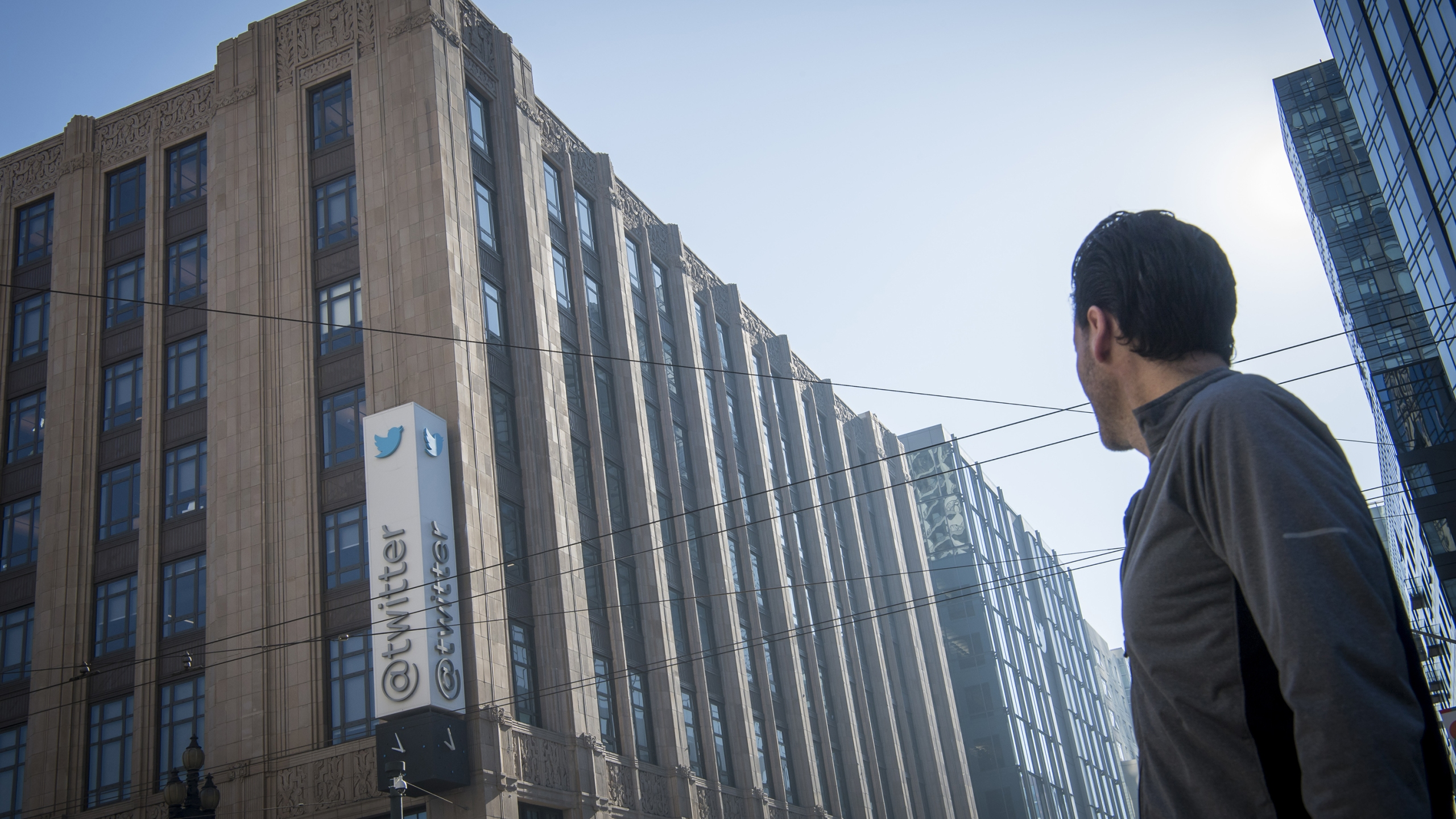 A pedestrian passes in front of Twitter Inc. headquarters in San Francisco, California, U.S., on Thursday, Feb. 8, 2018. (David Paul Morris/Bloomberg via Getty Images)
