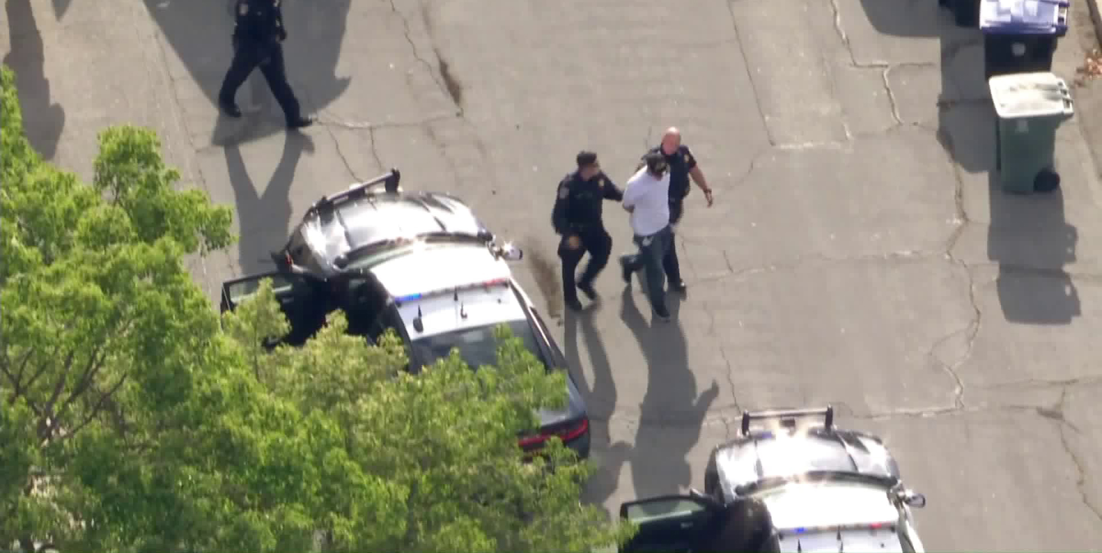 A driver who led authorities on a wild pursuit is taken into custody in Burbank on May 19, 2020. (KTLA)