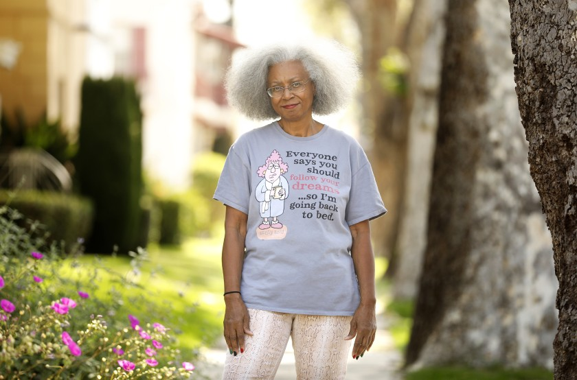 Jacquelyn Temple stands outside her home in Leimert Park in 2020. (Christina House / Los Angeles Times)
