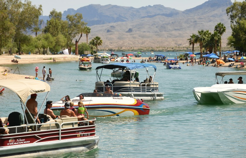 Boats pass through a channel in Lake Havasu City, Ariz., on May 9. The city has been crowded by an influx of Californians over the last few weekends.(Wally Skalij / Los Angeles Times)