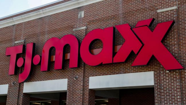 A sign hangs outside a T.J. Maxx store, Tuesday, May 16, 2017, in Cincinnati. (AP Photo/John Minchillo)