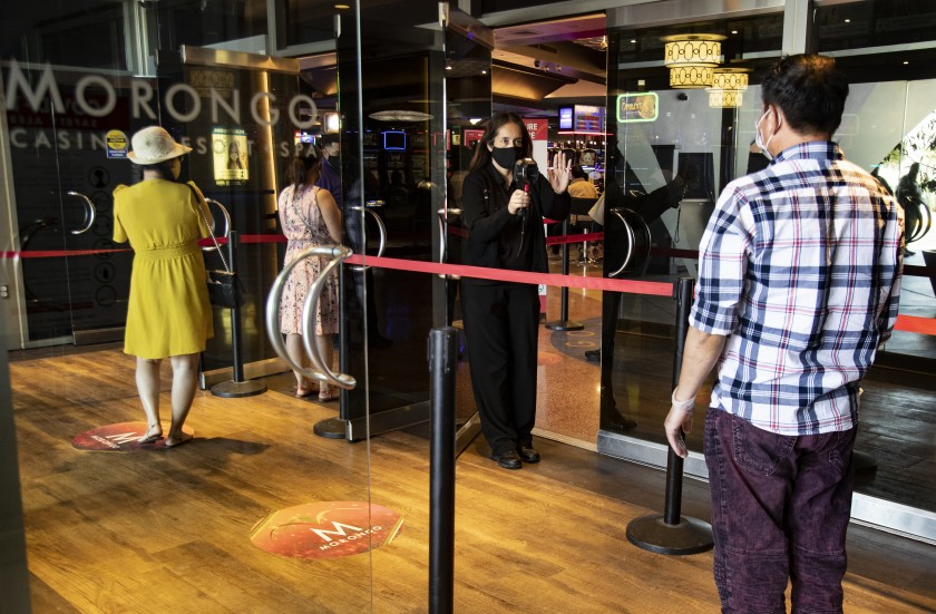 Patrons get their temperatures taken upon entering Morongo Casino, which reopened for the first time on May 22, 2020 since closing on March 17, 2020 because of the coronavirus pandemic. (Gina Ferazzi/Los Angeles Times)