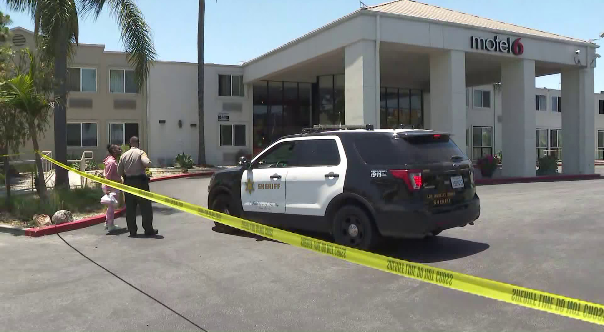 The parking lot of a Motel 6 in Carson was cordoned off after a man was found stabbed to death on May 28, 2020. (KTLA)