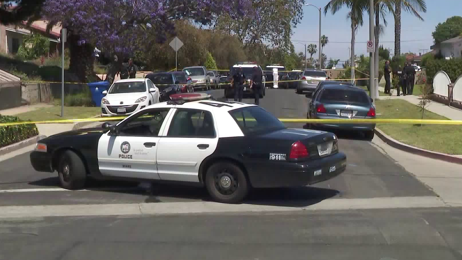 Investigators respond to the scene of a deadly police shooting in the Harbor Gateway neighborhood on May 14, 2020. (KTLA)