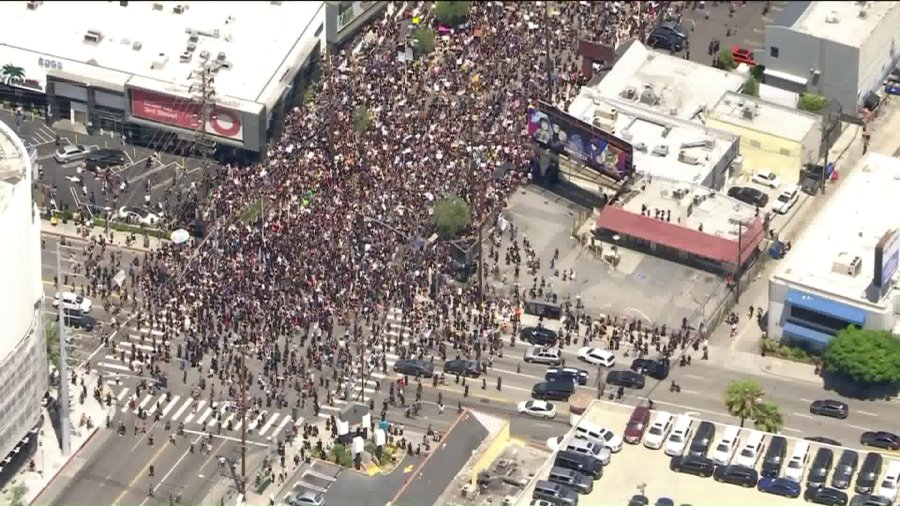 Outside the Beverly Center, protesters march through the streets of central L.A. on May 30, 2020, as part of nationwide demonstrations after the killing of George Floyd in Minneapolis. (KTLA)