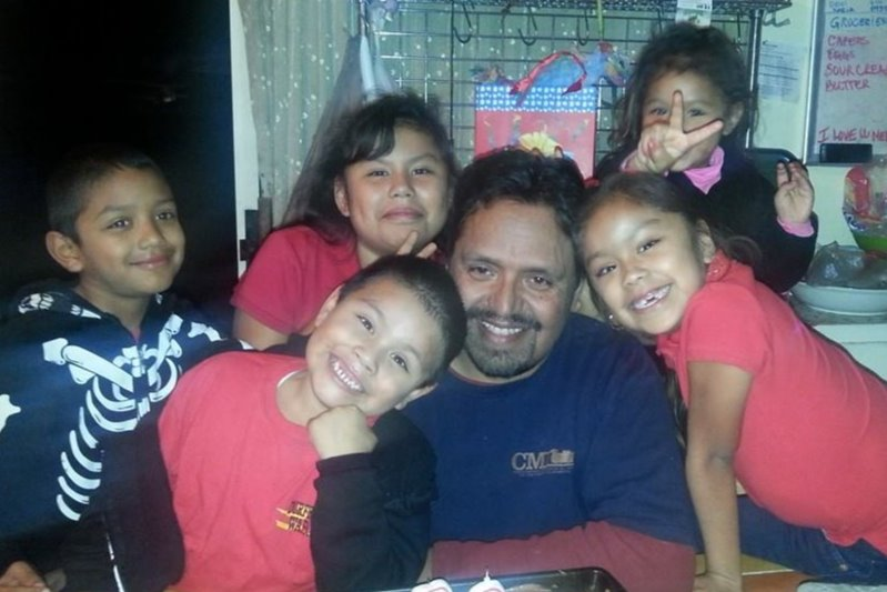 Rey Mendoza is seen with his grandchildren in a photo posted to GoFundMe on April 17, 2020.