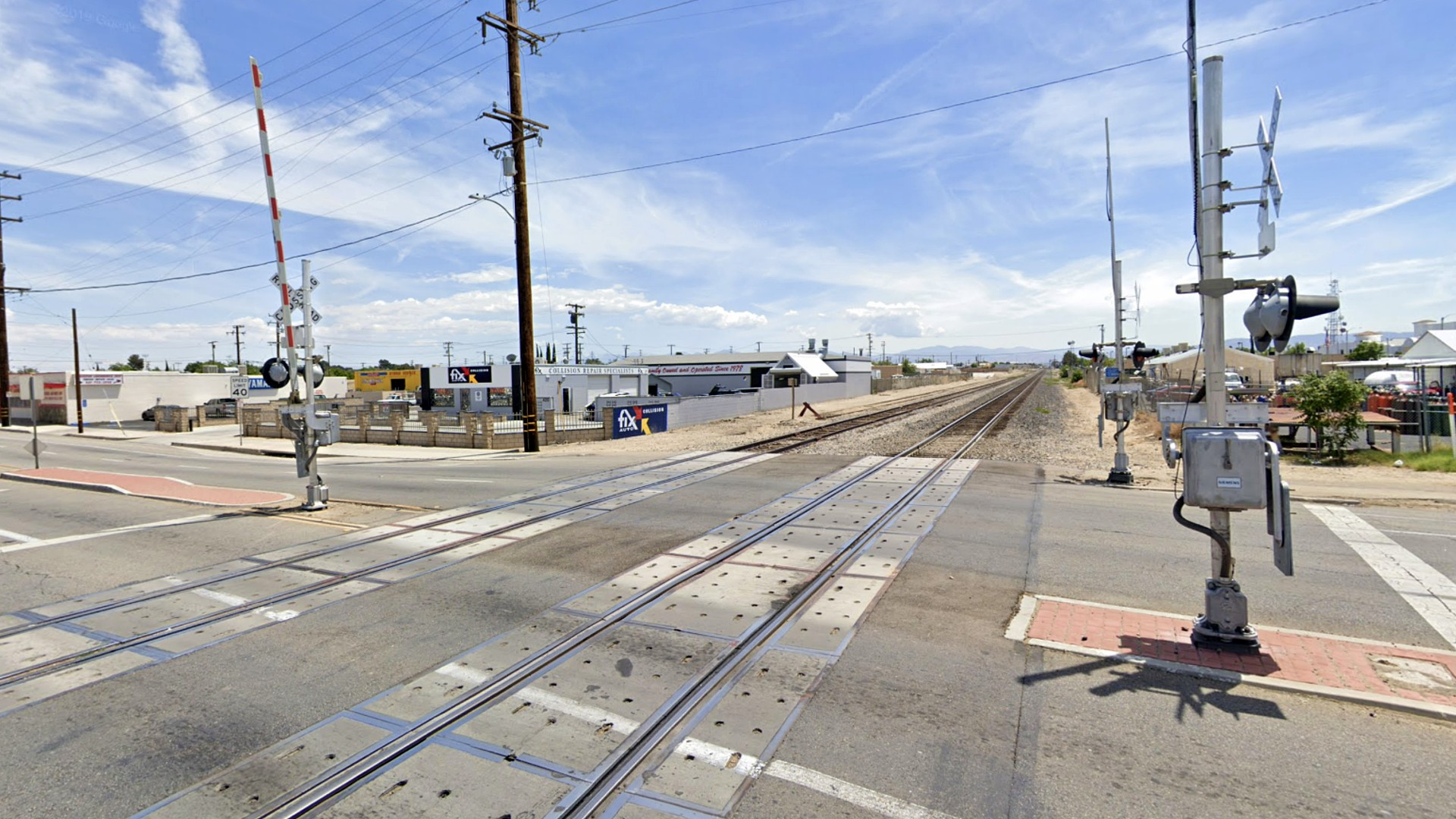 The train crossing on West Avenue I near Sierra Highway in Lancaster is seen in this image from Google Maps.