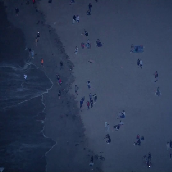 Dozens of people were congregated at Venice Beach while it was closed due to coronavirus restrictions on May 7, 2020. (KTLA)