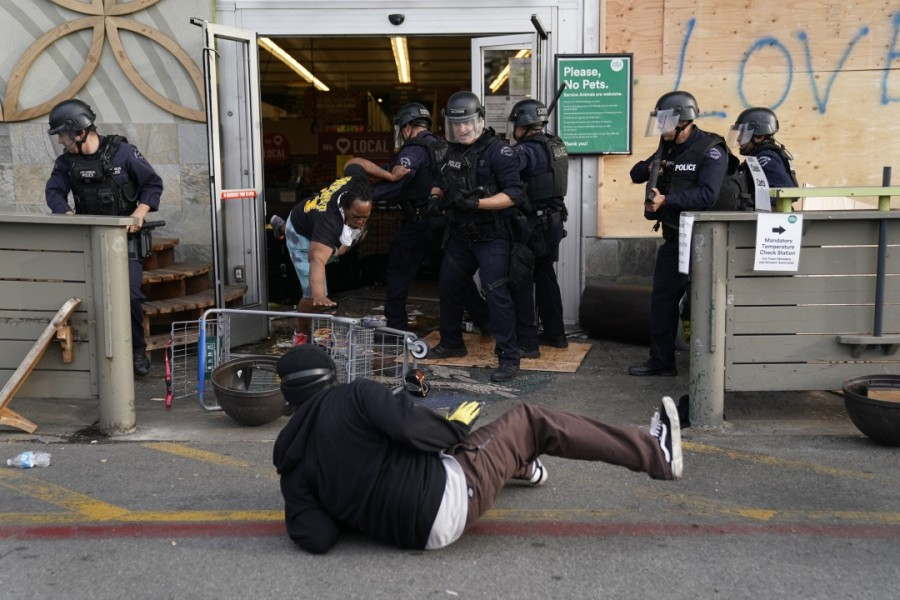 Protesters are thrown out of a Whole Foods Market in the Fairfax District of Los Angeles on May 30, 2020. (Kent Nishimura/Los Angeles Times)