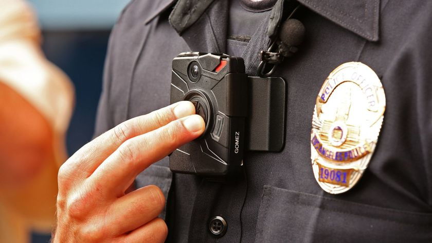 An LAPD officer demonstrates the use of a body camera in an undated photo. (Los Angeles Times)