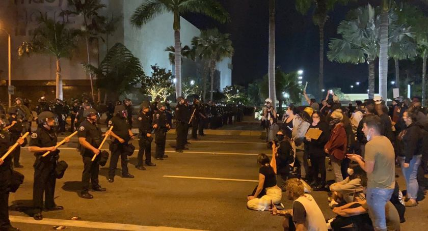 There was a series of standoffs between protesters and police at a rally at South Coast Plaza in Costa Mesa on June 1, 2020. (Ben Brazil / Los Angeles Times)