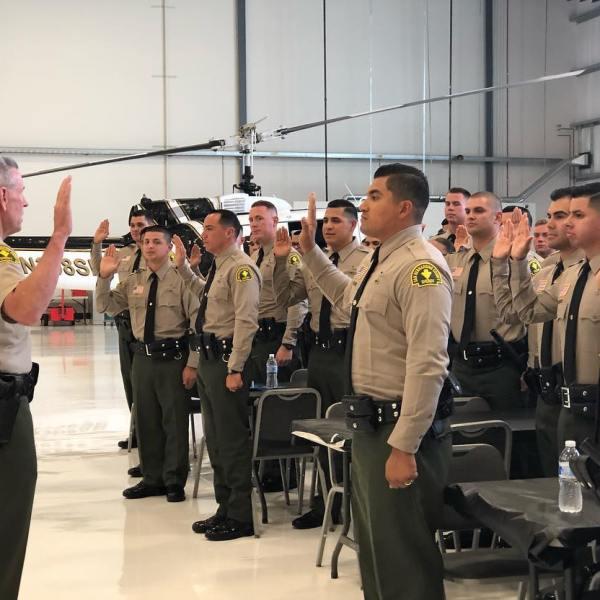 Deputy sheriffs are seen being sworn in to the San Bernardino County Sheriff's Department in 2018. (San Bernardino County Sheriff's Department)